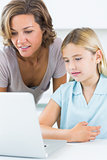 Mother and daughter using the laptop