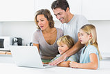 Happy family using laptop