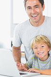 Happy son and father with laptop