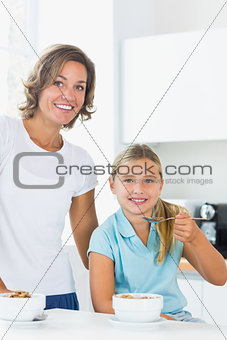 Mother and daughter having cereal
