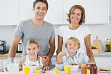 Happy family at breakfast