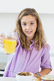 Girl offering orange juice