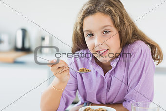 Little girl having cereal