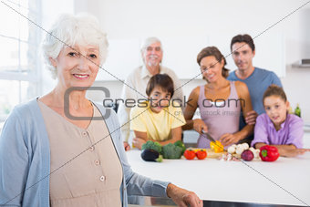 Grandmother standing beside kitchen counter