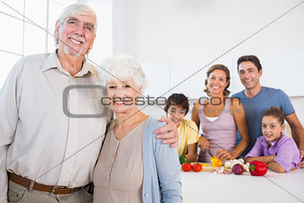 Grandparents standing by kitchen counter