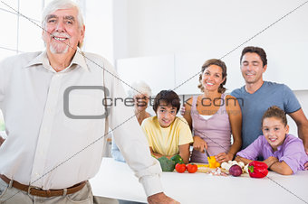 Grandfather standing beside counter in kitchen
