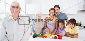 Grandfather standing by kitchen counter