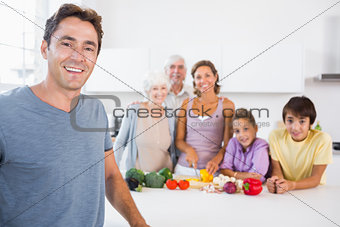 Father standing by kitchen counter