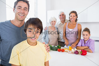 Father and son standing by kitchen counter