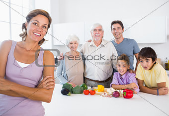 Mother standing by kitchen counter