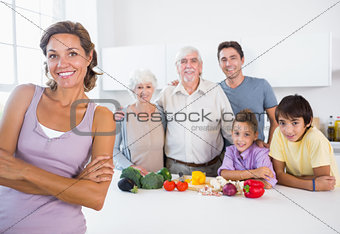 Mother standing beside kitchen counter