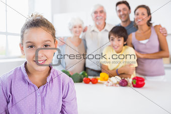 Young girl standing beside kitchen counter