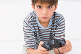 Boy playing his game console