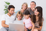 Happy family looking at laptop