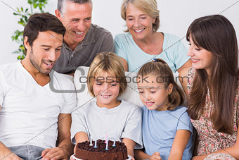 Family celebrating young boys birthday