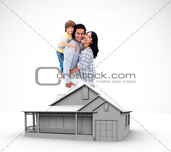 Family standing by graphic house