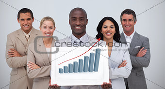 Smiling businessman holding a white card with graph