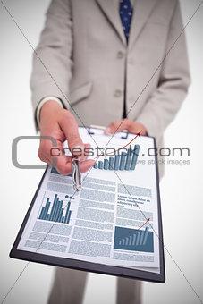 Businessman asking the camera for signature