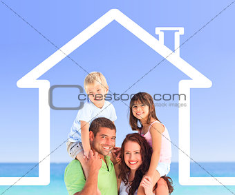 Family posing with a house illustration and the sea