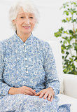 Aged woman sitting on sofa