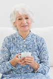 Elderly cheerful woman looking at camera