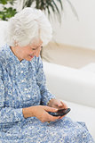 Elderly happy woman using a smartphone