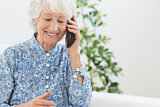 Elderly happy woman calling someone