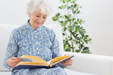 Elderly smiling woman looking at photos