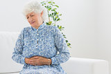 Elderly woman having a belly pain