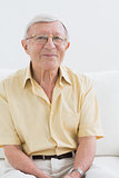 Smiling elderly man looking at camera
