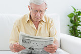 Focused aged man reading the news