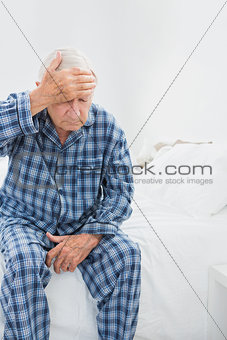Old man suffering on the bed