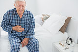 Elderly man suffering with belly pain