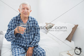 Old man with a water glass