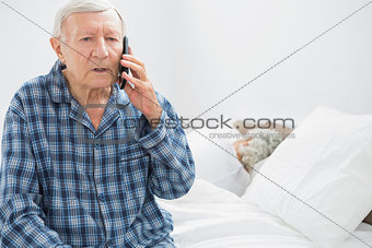 Old man on the phone sitting