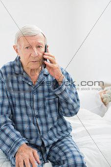 Old man calling someone