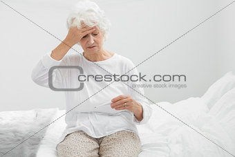 Aged woman suffering with fever