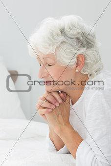 Aged woman praying