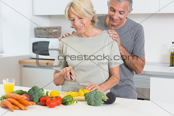 Couple cutting vegetables together