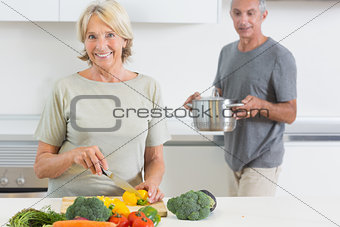 Husband bringing a pan to his wife