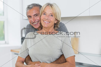 Happy mature couple hugging