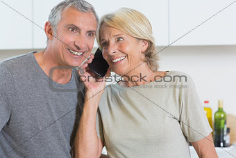 Couple taking a call together