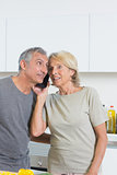 Mature couple listening a call together