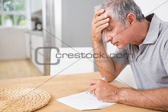 Focused man reading documents