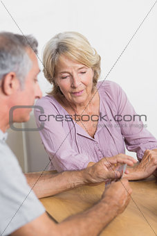 Husband and wife playing cards