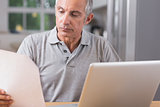 Mature man using his laptop