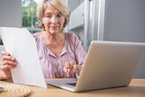 Stern mature woman using her laptop