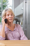 Serious mature woman calling