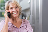 Happy mature woman calling