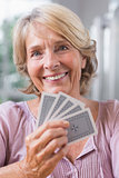 Close up of a smiling woman playing cards